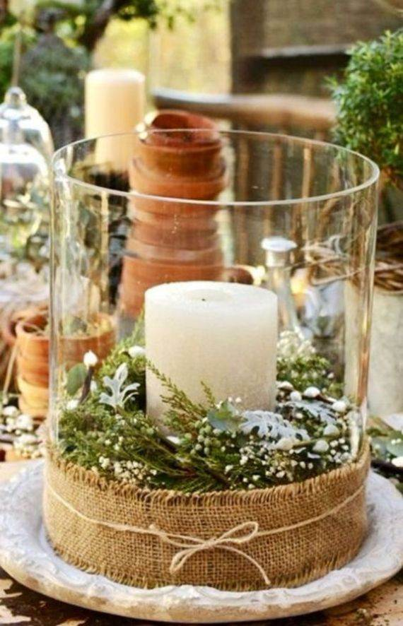 a-large-glass-lantern-with-evergreens-and-a-candle-wrapped-with-burlap