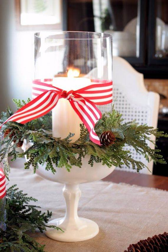candle-jar-wrapped-with-faux-greenery-pinecones-and-striped-ribbon