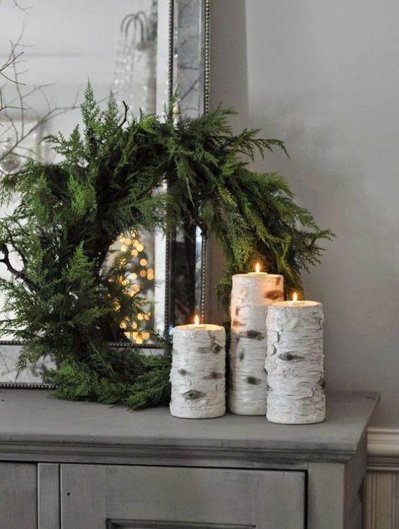 candles-wrapped-with-birch-bark-and-a-simpel-evergreen-wreath
