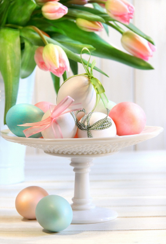 Colored eggs with bows and tulips