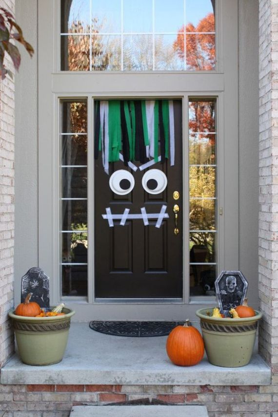 monster door decor with washi tape and googly eyes