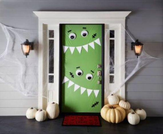 green-monster-door-decor-to-invite-tirck-or-treaters