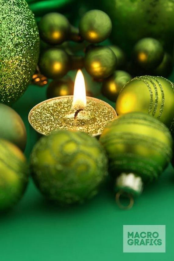 Green Holiday Candle with christmas decoration and copy space