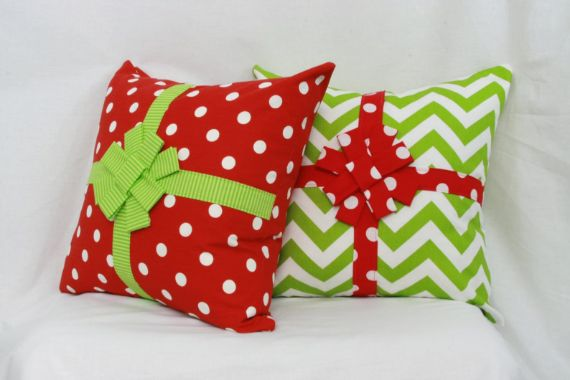 Christmas pillow in red polka dots and green stripes and bow.