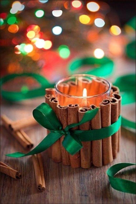 glue-cinnamon-sticks-around-a-glass-votive-jar-and-tie-with-a-ribbon