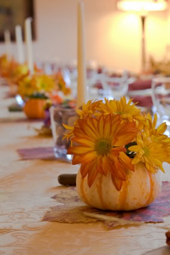 Table decorated for a large thanksgiving gathering.