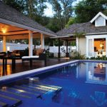 Nestled Between Lush Tropical Mountain Greenery: Banyan Tree Seychelles