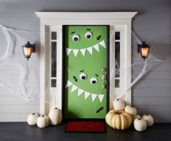 green-monster-door-decor-to-invite-tirck-or-treaters