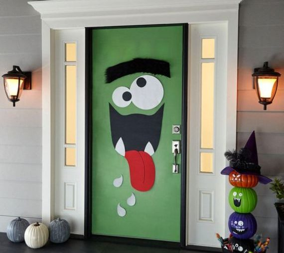 trick-or-treaters and other guests are sure to be delighted with such monster door decor