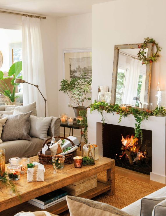 fireplace-decorated-with-christmas-garland. A delicate and natural fireplace