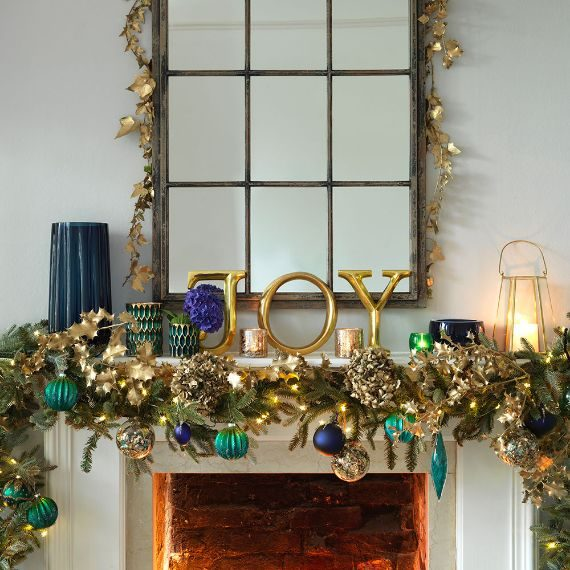Christmas mantelpiece with festive message