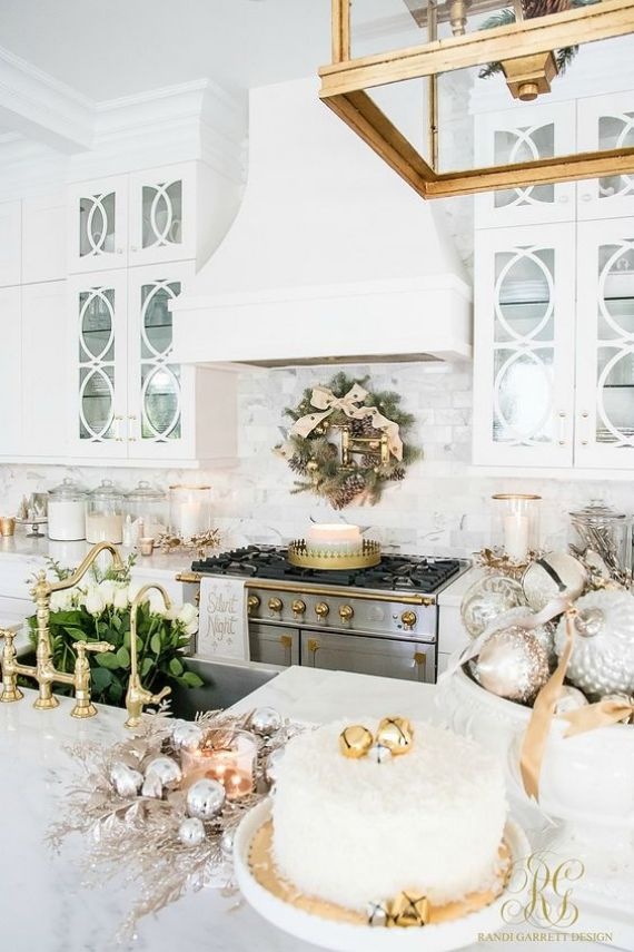 an-evergreen-Christmas-wreath-with-metallic-ornaments-metallic-ornaments-in-bowls-silver-ornaments-wreaths-and-candles