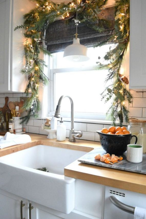 evergreens-and-greenery-Christmas-garland-with-pinecones-and-lights-for-decorating-the-kitchen