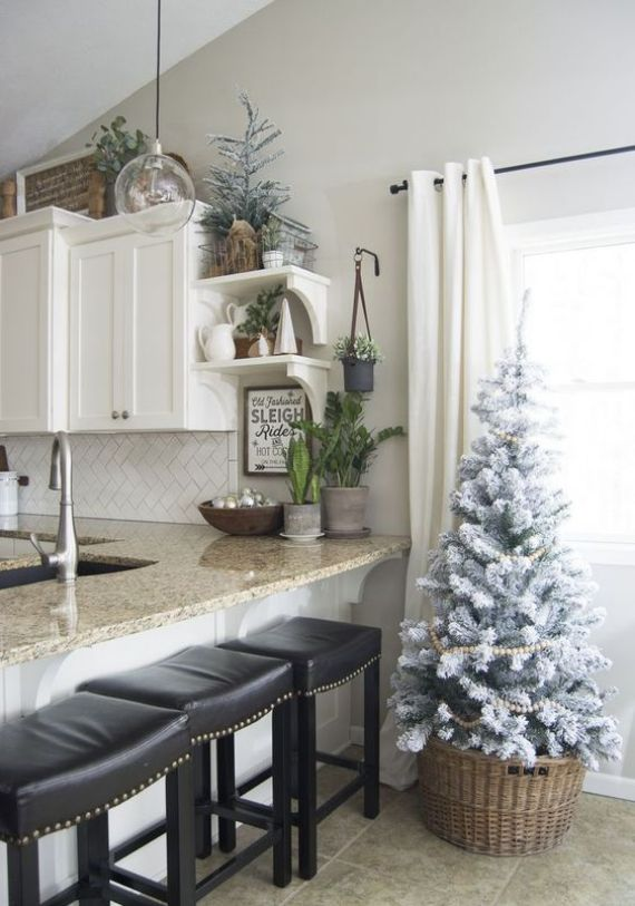 flocked-Christmas-trees-with-wooden-bead-garlands-will-bring-a-slight-Christmas-feel-to-the-space