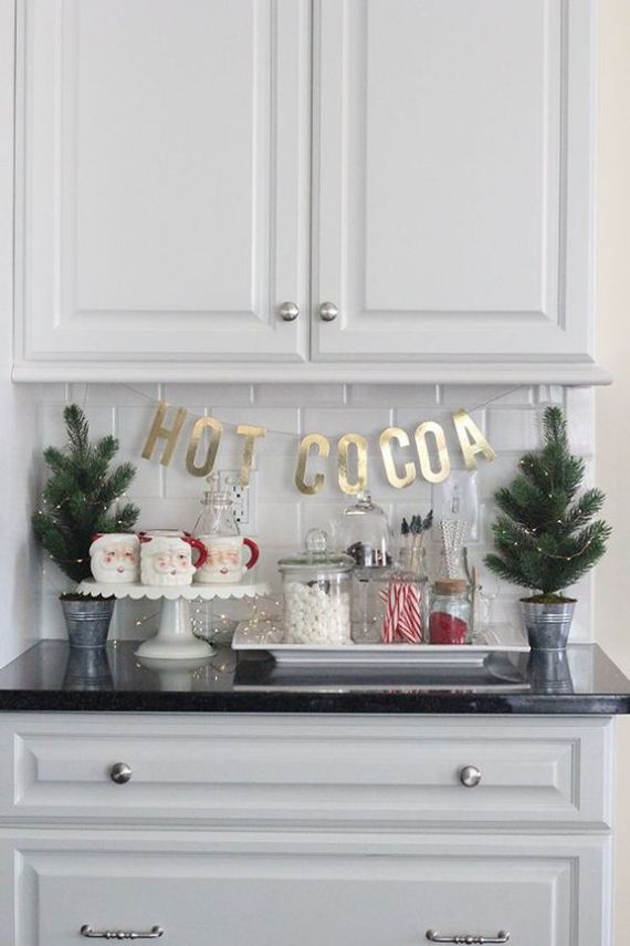 mini-Christmas-trees-with-lights-Santa-mugs-sweets-and-gold-letters-for-a-cool-and-cute-Christmas-nook