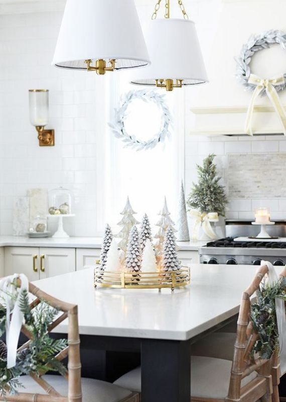 whitewashed-evergreen-wreaths-a-mini-Christmas-tree-candles-ornaments-and-a-white-Christmas-tree-centerpiece