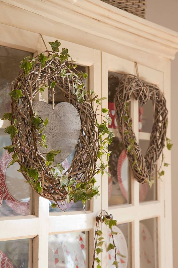 wreath hanged on the door of cabinets or cabinets